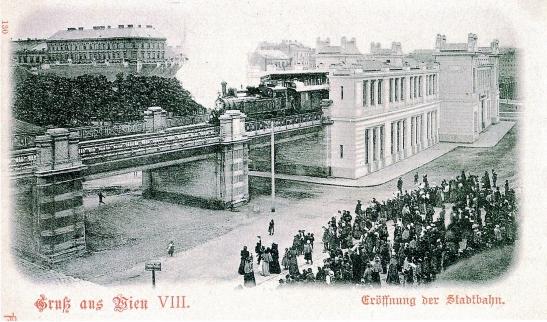 """""""Gruß aus Wien!"""" (1898). Ansichtskarte zur massenwirksamen Eröffnung der Wiener Stadtbahn im selben Jahr. Urheber unbekannt. Wikimedia Commons."""